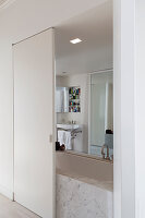 View into ensuite bathroom through open sliding door