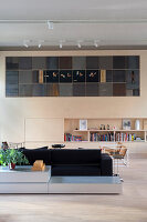Living room wall with integrated artwork in loft apartment