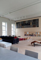 Living room wall with integrated artwork in open-plan interior of loft apartment