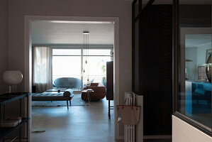 View from hallway with black metal console table into living room