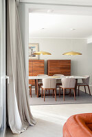 Marble-topped dining table, designer chairs and twin tallboys