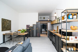 Wood and metal furnishings in open-plan kitchen