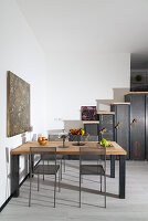 Dining table with solid wooden top and metal chairs