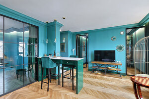Open-plan apartment with turquoise colour scheme