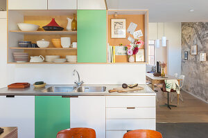 Kitchen counter, shelves and green-and-white cabinets