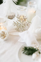Table set for Christmas meal in shades of cream