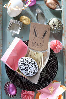 Easter bunny in fringed dress on greetings card and decorations