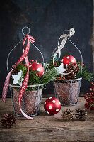 Festive arrangements of fir branches and polka-dot baubles