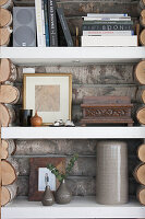 Shelving panelled with rustic logs