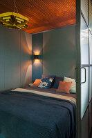 Double bed in bedroom with sliding door