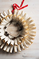 Wreath hand-crafted from newspaper and book pages