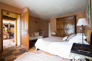 Rustic bedroom with open door