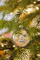 Christmas bauble hanging from branch