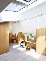 Study on first floor with custom wooden furnishings and skylights