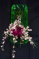 Modern bouquet of carnations and pink broom