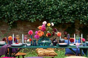 Dahlias on festively set table outdoors