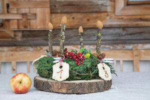 Advent wreath with numbered biscuits and wooden candles