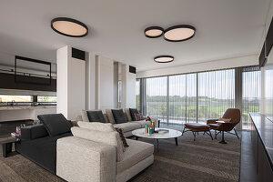 Modernes Wohnzimmer mit säulenartigen Schränken als Raumteiler