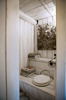 Toilet with fitted wooden surround in white country-house-style WC
