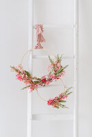 DIY spring wreath made from wooden hoops and dried flowers