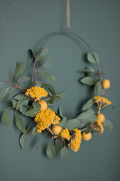 Wreath of eucalyptus twigs, yarrow and yellow felt balls