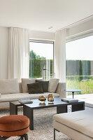 Floor-to-ceiling windows in elegant living room overlooking garden