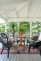 An antique table with comfortable chairs on a covered terrace