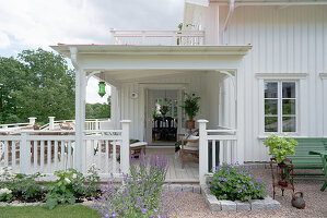 A view of a covered wooden porch