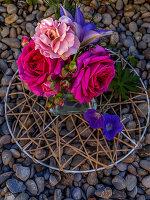 Arrangement of roses, crane's bill geraniums and clematis