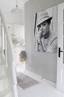 Black-and-white photo of Romy Schneider in grey and white hallway