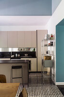 A bright fitted kitchen with an island