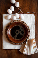 White eggs and bowl of coffee for dying