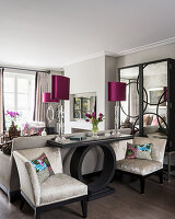 Cushions on armchairs with console and mirrored cabinet