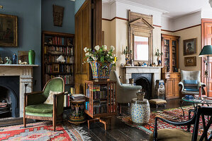 Arts and Crafts style revolving bookcase and cabinet in drawing room