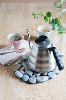 DIY trivet made from pebbles