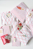 Gifts for an Advent calendar wrapped in hand-decorated paper