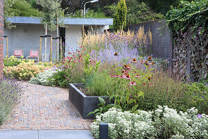 Flowerbeds with and without edging and a paved path in a garden