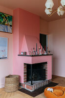 A fireplace in dusky pink in a living room