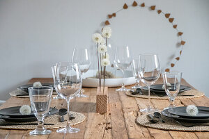 Dandelions in a wooden strip as table decoration