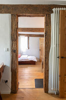 View into the bedroom of a renovated half-timbered house