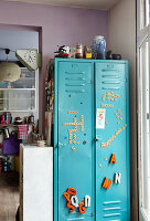Turquoise blue metal cupboard with decorative letters