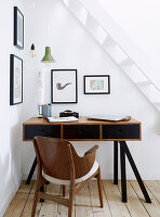 Small workstation under white staircase