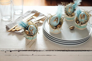 Dyed Easter eggs with golden adhesive letters used as place cards
