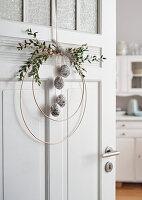 Door wreath with decorative eggs
