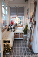 Benches and wintry decorations in porch