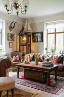Living room with antique furniture and leather couch