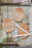 Cork eggs with coloured paper as coasters or place mats
