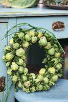 Autumn wreath of Brussels sprouts and boxwood