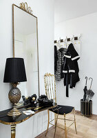 Elegant hallway in black, white and gold