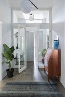 Hallway with retro secretary and houseplant